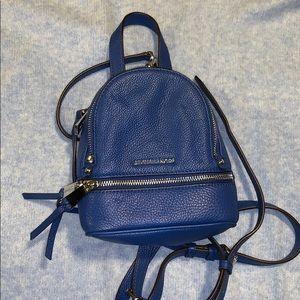 Blue Michael kors mini backpack.
